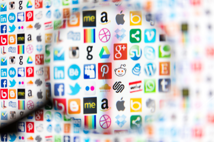 London, United Kingdom - April 18, 2016: Popular social media and technology icons photographed on a computer screen. The logos include Instagram, Behance, Google plus, pinterest, Dropbox, amazon, twitter, Facebook, apple, whatsapp